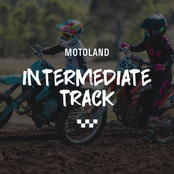 two motocross riders racing on a track at motoland